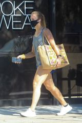 Abby Champion Checks her phone after grocery shopping in Beverly Hills