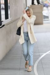 Mollie King Looks chic in cream jacket takes an important phone call at the BBC studios in London