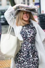 Kate Garraway Used a stack of newspapers as an umbrella looking chic in a print dress at Smooth radio in London
