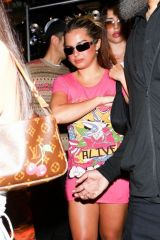 Addison Rae Donning a vibrant pink dress leaving Carter Gregory's birthday party at 40 Love in West Hollywood