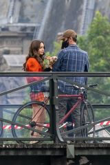 Lily Collins and Charlie McDowell are seen on the set of 'Emily in Paris' Season