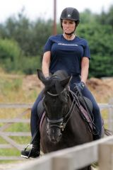 Katie Price Seen out exercising her horse in the evening at her stables in Essex