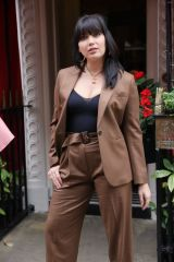 Daisy Lowe Makes a busty appearance in a brown trouser suit at Paul & Jo fashion show in London
