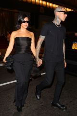Kourtney Kardashian And Travis Barker holding hands while going out for dinner this evening in New York