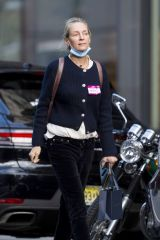 Uma Thurman Hails a taxi cab during a rare sighting in New York City