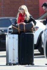 Sylvie Meis Stands in a car park with her bags after posting a glamorous Instagram photo outside the Beverly Hills Hotel