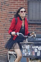 Famke Janssen Seen cycling wearing a red bomber jacket paired with black tutu skirt in the West Village in New York