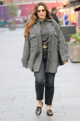 Kelly Brook In a stylish coat as she steps in for Amanda Holden at Heart radio in London