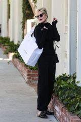 Melanie Griffith Films a commercial as she shops at Violet Grey on Melrose Place in West Hollywood