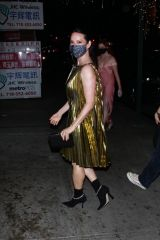 Lucy Liu Seen in a shiny gold dress on a night out in New York