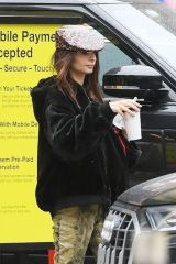 Emily Ratajkowski Feeds baby Sly as they wait for her car in New York