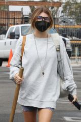 Olivia Jade Giannulli Showing off her toned legs as she heads into the DWTS studio early on Saturday carrying a prop sledge hammer in Los Angeles
