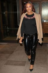 Alexandra Burke Wearing a shiny trousers and She Who Dares Wins slogan top as she steps out from trendy White City House in London