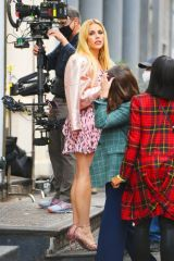 Busy Philipps Wears a pink spotted dress and heels while on set in New York