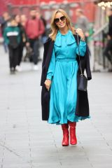 Amanda Holden Looks chic in a striking blue flowing dress and knee high boots at Heart radio in London
