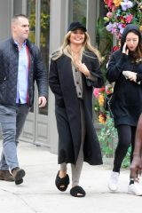 Chrissy Teigen All Smiles as She Steps Out With a Friend in New York City