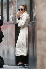 Mary-Kate and Ashley Olsen are pictured having a smoke break outside of their offices in New York City