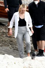 Dakota Fanning Posing for a shooting on the beach and on a boat while filming Mr. Ripley in Atrani