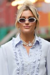 Ashley Roberts Looks chic in a stylish detailed sky blue blouse and beige trousers at Heart radio in London