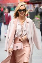 Amanda Holden Looks chic in pink stepping out from Heart radio in London