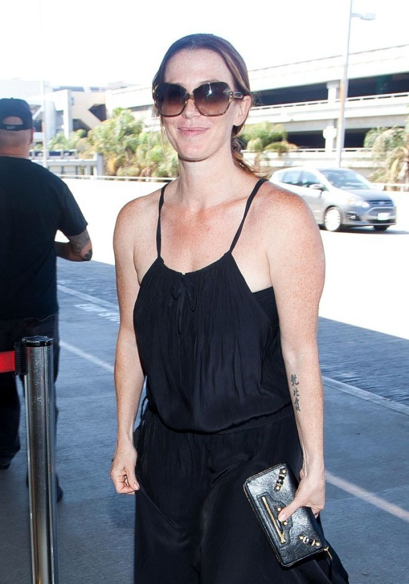 Poppy Montgomery At LAX Airport