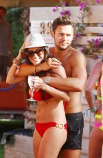 Casey Batchelor Seen Poolside With Friends In Ibiza