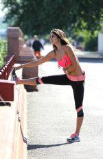 Leilani Dowding Jogging & Playing Fetch At Battersea Park
