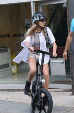Cara Delevingne Riding A Bicycle In London