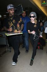 Emma Roberts Arriving At LAX