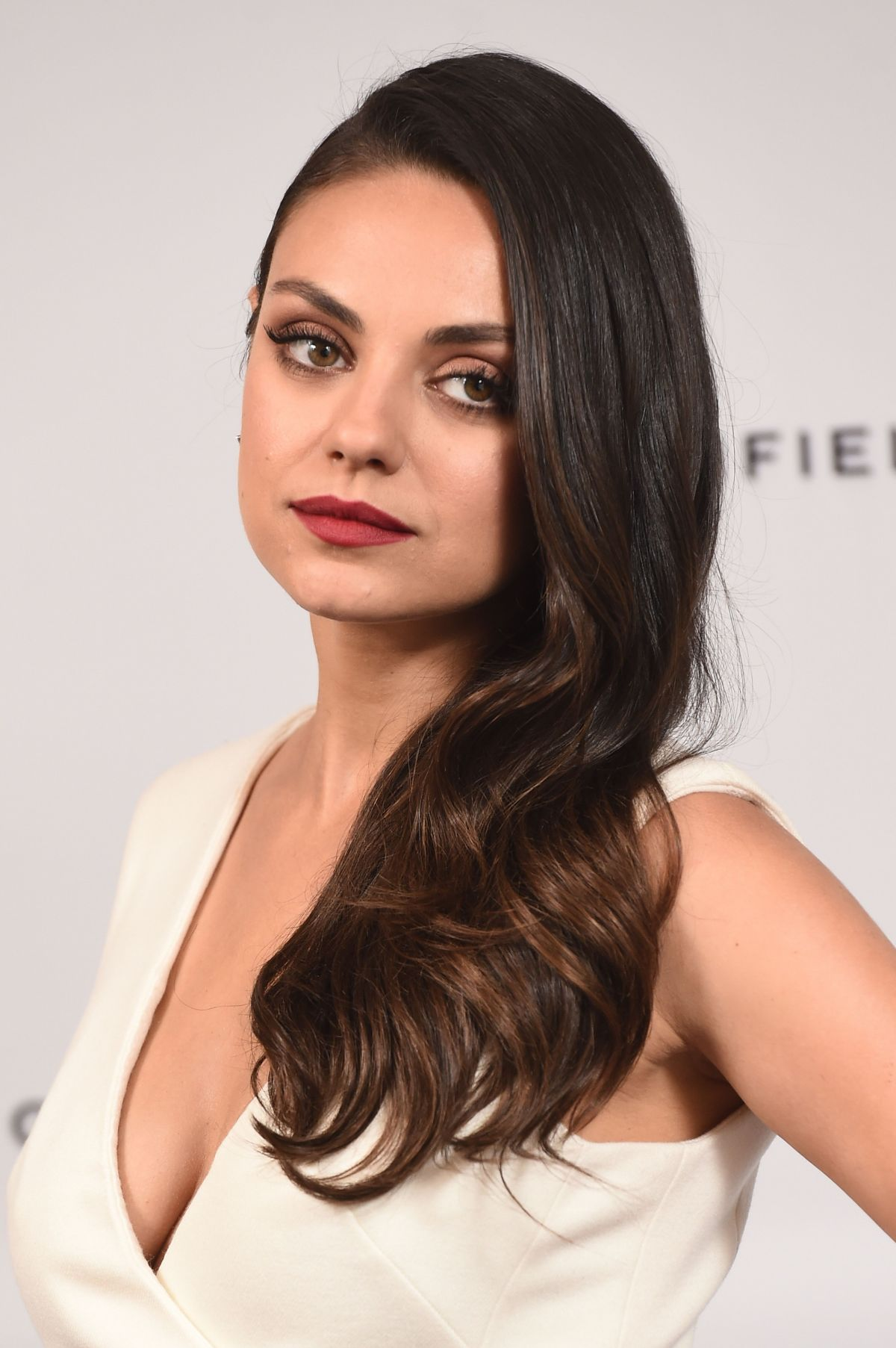 Mila Kunis At Gemfields Photo Call - Celebzz - Celebzz Mila Kunis