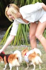 Kate England Posing With Her Dogs In Miami