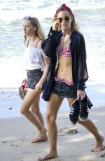 Suki and Immy Waterhouse In Bikinis On A Beach In Barbados