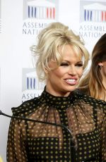Pamela Anderson Gives A Press Conference With French Deputy Laurence Abeille In Paris