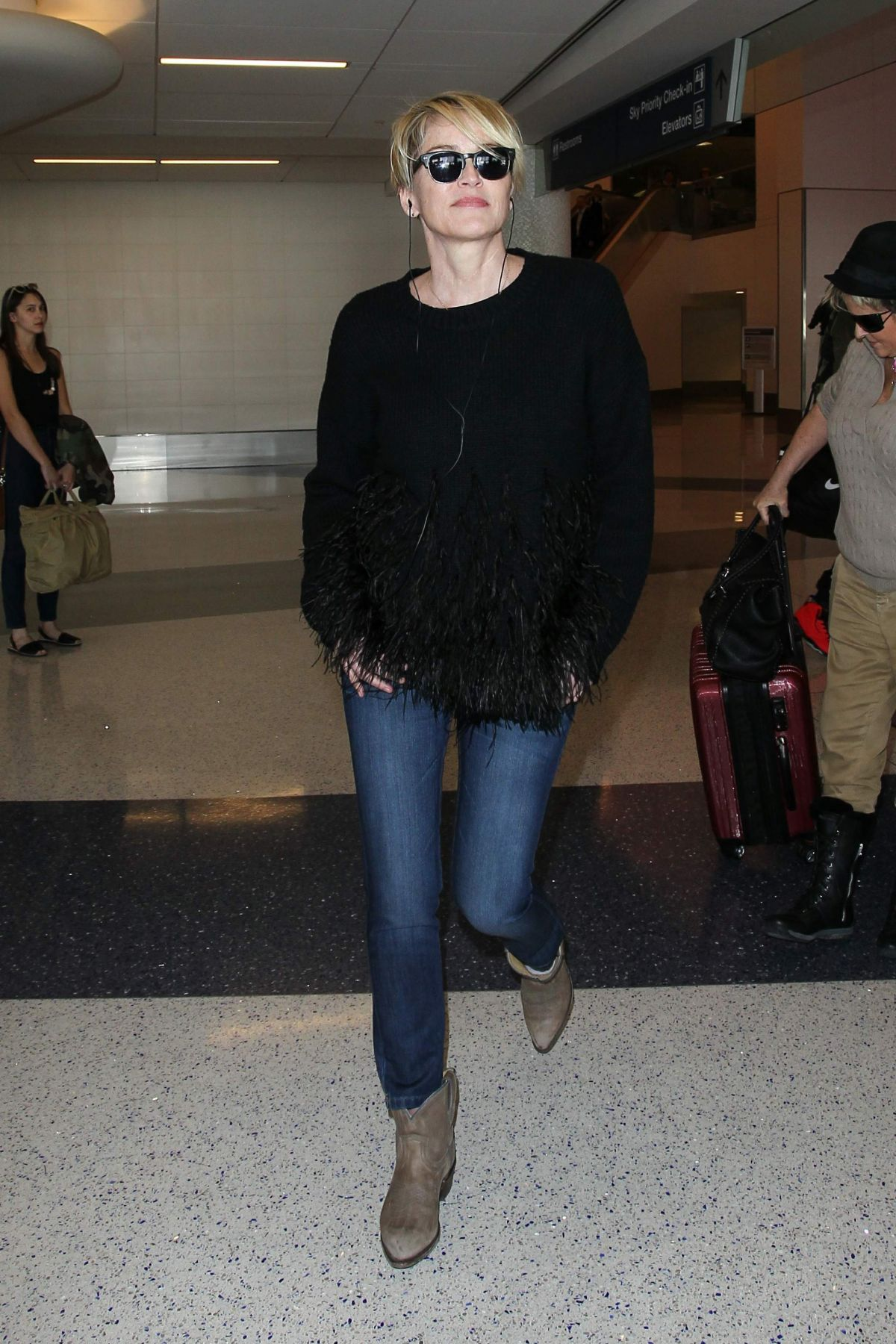 Sharon stone arrives casual and confident at lax celebzz for Tile fashion 2016