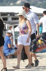Ellie Goulding In a swimsuit is spotted on the beach at Club 55 in St Tropez