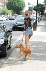Kimberley Garner Walking her dog in London