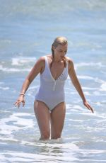 Margot Robbie In a One Pieace Swimsuit Wipes Out Surfing in Hawaii