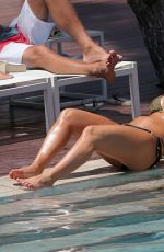 Megan Mckenna In bikinis at a pool in Mallorca