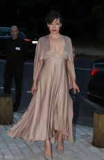Milla Jovovich Arrives at the Art Of Giving Love Ball in Paris