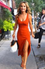 Giada De Laurentiis Turns up the heat in a low-cut orange dress for NYC lunch