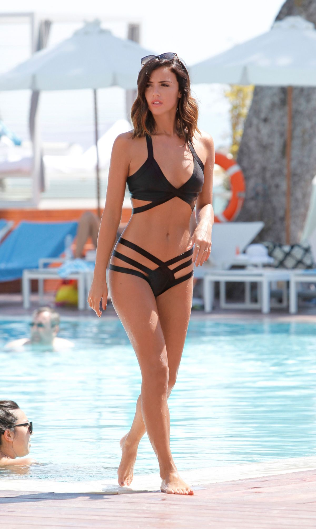 Lucy Mecklenburgh Wearing a bikini by the pool in Mallorca