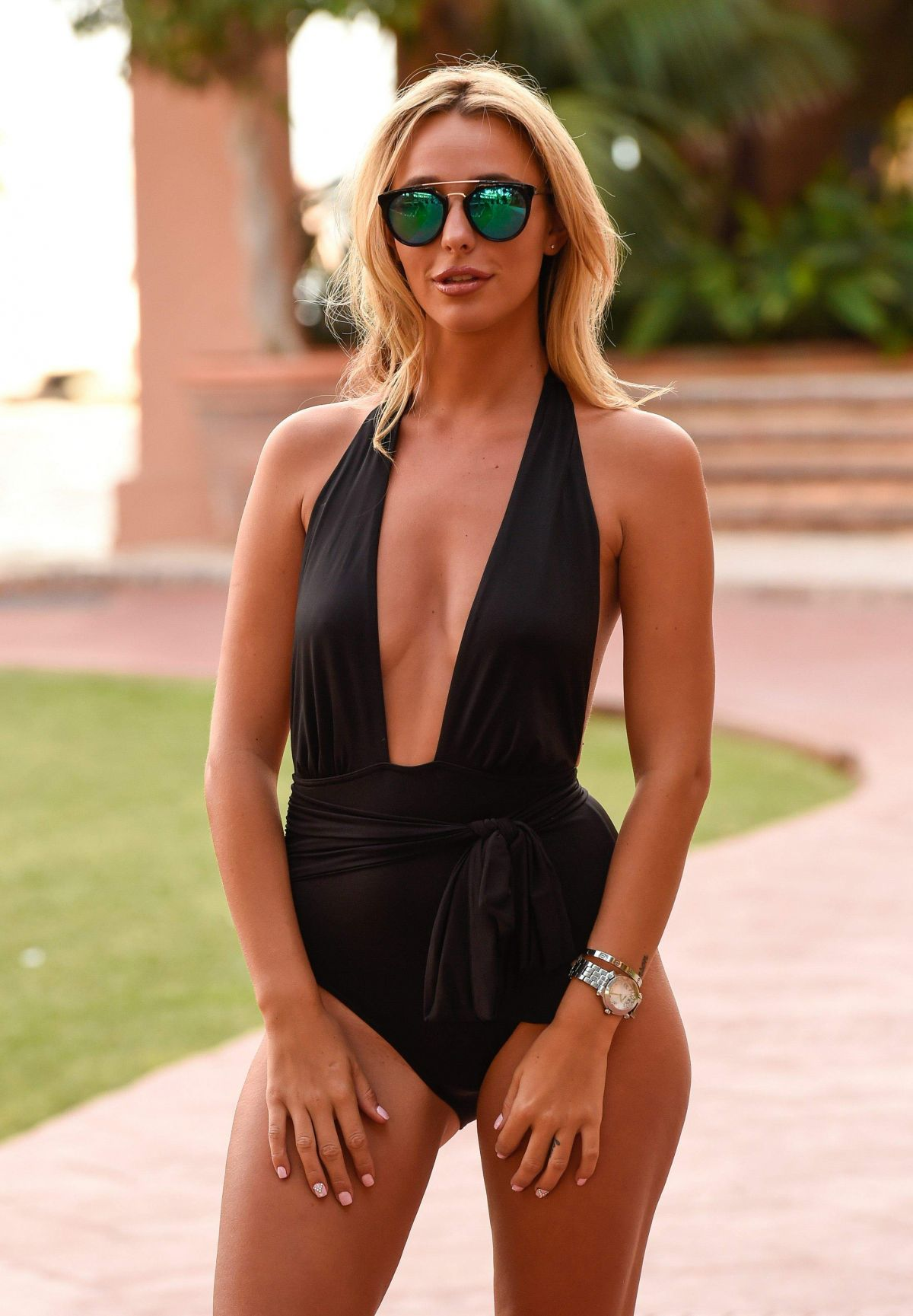 Amber Dowding leaves her hotel in marbella, spain