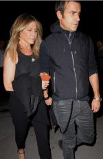 Jennifer Aniston and justin theroux walk along hand in hand after dining at the smile restaurant in NYC