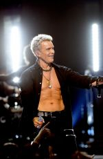 Miley Cyrus joins billy idol onstage during the iheartradio festival