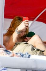 Heather Graham Relaxed in the sun at the beach in Miami