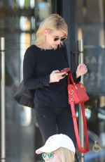 Emma Roberts and Lea Michele shopping at Barneys New York in Beverly Hills