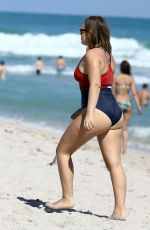 Tanya Burr Enjoys a beach day in red bathing suit in Miami