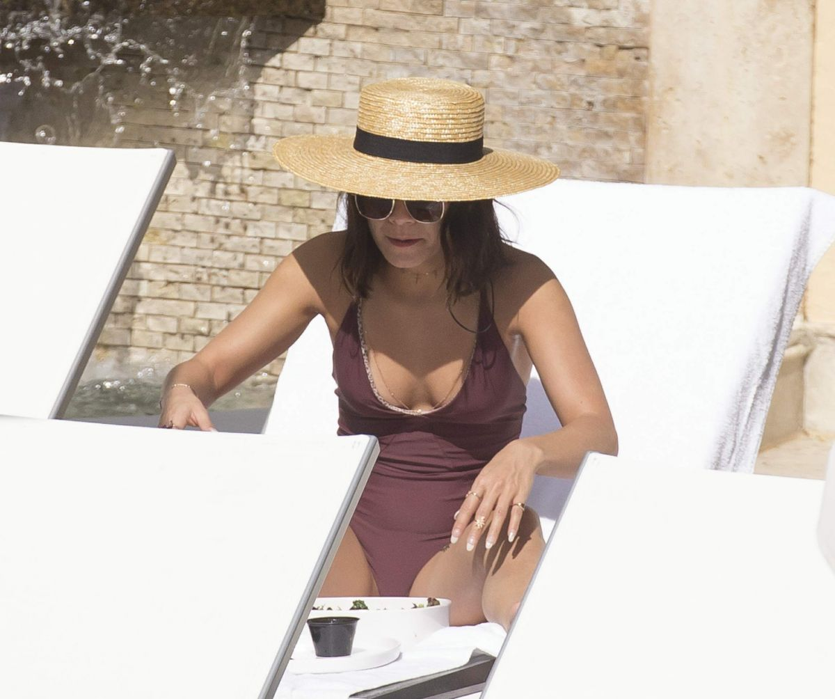 Vanessa Hudgens Relaxes by the pool in Miami