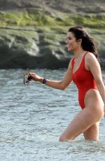 Jessica Cunningham In a red baywatch swimsuit In Tenerife, Spain