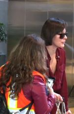 Milla Jovovich Enjoying a cigarette after her flight back to Los Angeles
